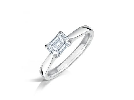 Unusual Emerald Cut Diamond Engagement Ring