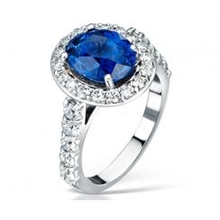 Blue Sapphire And Diamond Cluster Engagement Ring In Platinum